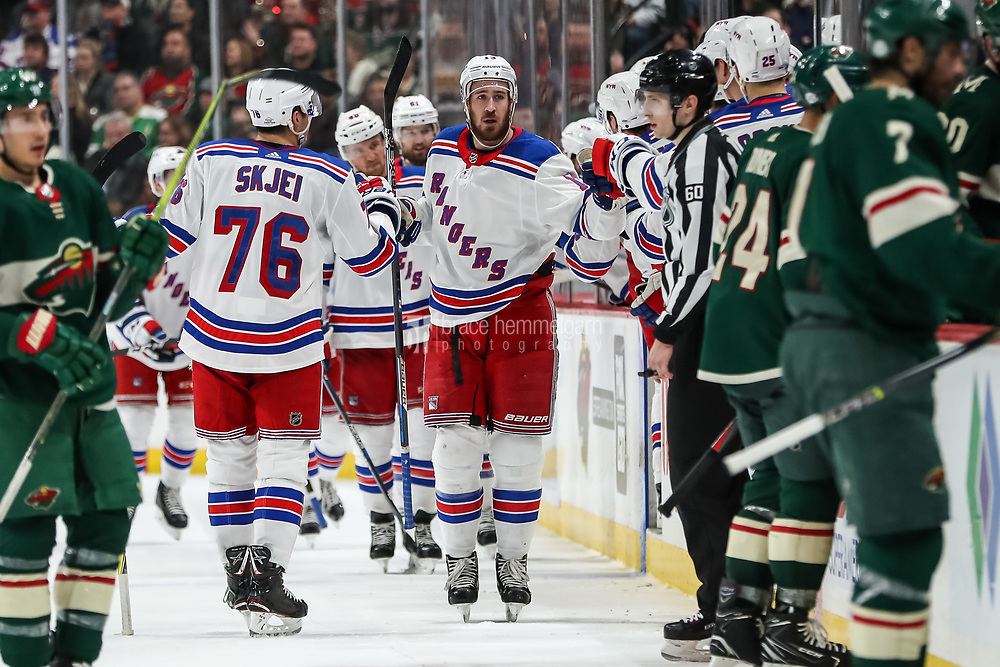 Feb 13, 2018; Saint Paul, MN, USA; New York Rangers forward Kevin Hayes (13) celebrates his goal with teammates during the second period against the Minnesota Wild at Xcel Energy Center. Mandatory Credit: Brace Hemmelgarn-USA TODAY Sports