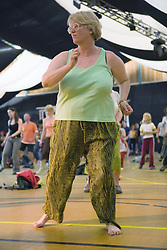 Women taking part in a Jazz CoTech street jazz dance workshop at the WOMAD (World of Music; Arts and Dance) Festival in reading; 2005,