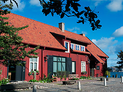 Exterior of historic red wooden Sjomagasinet gourmet restaurant in Gothenburg Sweden