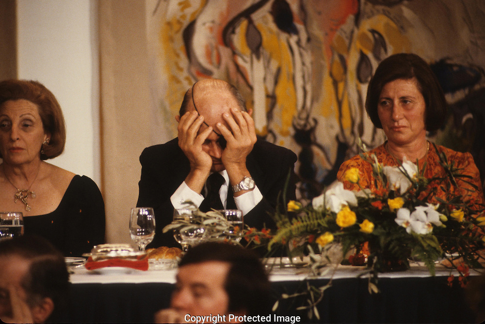 Moshe Dayan relaxes at a state dinner for President Carter in Israel in March 1979<br /> <br /> Photograph by Dennis Brack<br /> bb45
