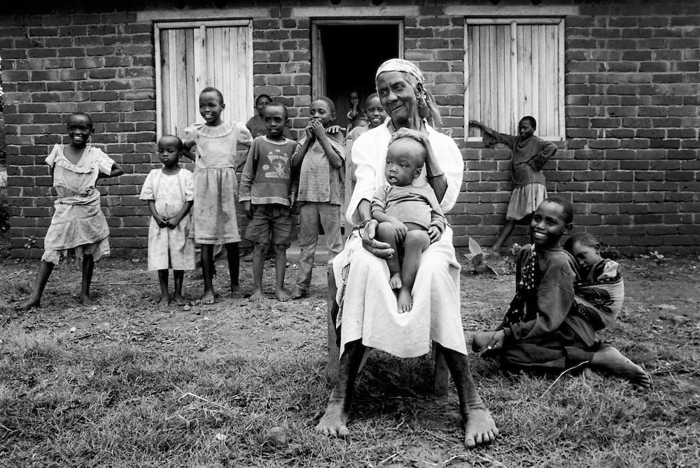 Nzisa Mutiso with some of her children and grandchildren in front of her Habitat home outside of Nairobi, Kenya.