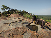"Mokoa visits a place named ""Dundubi"" - there are 2 such places. Large rocks are found overlooking the savannah. The rocks, once hit, resonates, ""talking"" to the Hadza. One is said The Hadza camp of Senkele."
