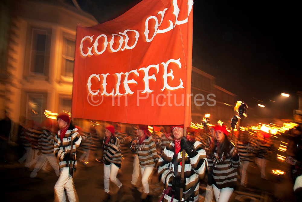 Lewes, UK. Monday 5th November 2012. Cliffe bonfire society members. Bonfire Night celebration in the town of Lewes, East Sussex, UK which form the largest and most famous Guy Fawkes Night festivities. Held on 5 November, the event not only marks the date of the uncovering of the Gunpowder Treason and Plot in 1605, but also commemorates the memory of the 17 Protestant martyrs from the town burnt at the stake for their faith during the Marian Persecutions of 1555–57. There are six bonfire societies putting on parades involving some 3,000 people.