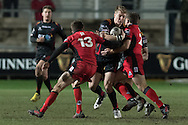 Tyler Morgan of the Newport Gwent Dragons tries to force his way between Chris Dean (l) and Duncan Weir (r) of Edinburgh. Guinness Pro12 rugby match, Newport Gwent Dragons  v Edinburgh rugby at Rodney Parade in Newport, South Wales on Sunday 27th November 2016.<br /> pic by Simon Latham, Andrew Orchard sports photography.