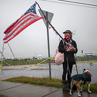 LITITZ, PA - OCTOBER 26: Karen Heck demonstrates with her dog outside the venue where President Donald Trump will hold a rally on October 26, 2020 in Lititz, Pennsylvania.  With 8 days to go before the election, Trump is holding 3 rallies across Pennsylvania, a crucial battleground state.  In 2016, Trump won Pennsylvania by only 44,000 votes out of more than 6 million cast, the first Republican to carry the Keystone State since 1988. (Photo by Mark Makela/Getty Images)