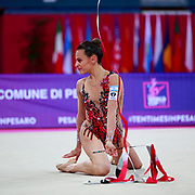 Ashram Linoy during qualifying at ribbon in Pesaro World Cup at Adriatic Arena on April 14, 2018. Linoy  is an Isrlaelian rhythmic gymnastics athlete born on May 13,1999 in Tel Aviv. Her targhet is to win Israel's first Olympic rhythmic gymnastics medal at the 2020 Olympic Games in Tokyo.