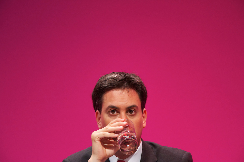 Ed Miliband takes a sip of water while listening to a speech during the Labour Party Conference in Manchester on 29 September 2010, the penultimate day of annual assembly.
