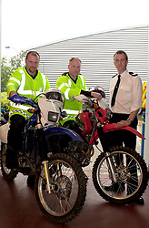 Sgt Simon Slack (far right) with PC Neil Fletcher and PC Garry Kelsall members from the Off Road Biking Unit , which is part of the Road Policing Group.<br />Image Copyright Paul David Drabble<br /><br />27 June 2003<br /><br />Copyright  Paul David Drabble<br />[#Beginning of Shooting Data Section]<br />Nikon D1 <br />2003/06/27 15:03:40.5<br />JPEG (8-bit) Fine<br />Image Size:  2000 x 1312<br />Color<br />Lens: 24mm f/2.8<br />Focal Length: 24mm<br />Exposure Mode: Manual<br />Metering Mode: Multi-Pattern<br />1/80 sec - f/4.5<br />Exposure Comp.: 0 EV<br />Sensitivity: ISO 400<br />White Balance: Auto<br />AF Mode: AF-S<br />Tone Comp: Normal<br />Flash Sync Mode: Front Curtain<br />Auto Flash Mode: Manual<br />Color Mode: <br />Hue Adjustment: <br />Sharpening: Normal<br />Noise Reduction: <br />Image Comment: <br />[#End of Shooting Data Section]