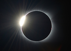 August 21, 2017 - Laurens, South Carolina, U.S. - The sun peaks out during a total solar eclipse as viewed from downtown Laurens. (Credit Image: © Fabian Radulescu via ZUMA Wire)