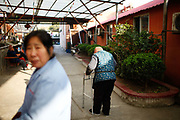Residents warm themselves in the afternoon sun at a small community run retirement home on the outskirts of Shanghai, China, on Tuesday, Dec. 13, 2011. China has about  36000 institutions and 2.7 million beds serving the elderly, enough for 1.6 percent of the population over 60, according to the World Bank.