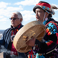 Larry Foster, 69, left, heals the circle during a ceremonial smudging as Dan Nanamkin, 50, right, sings before the group begins the Missing and Murdered Indigenous Women and Girls Walk in Ft. Defiance Friday.