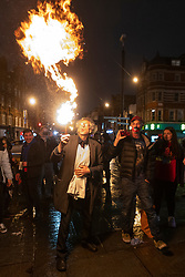 © Licensed to London News Pictures. 30/10/2020. London, UK. PIERS CORBYN is seen practicing fire breathing in front of demonstrators attending an anti Covid-19 street party in Camden Town, North London. The event was held in support of the hospitality industry who have operated under strict lockdown rules. Police officers did not intervene in the demonstration. Photo credit: London News Pictures