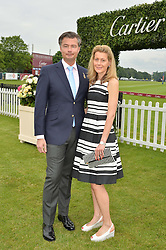 LAURENT FENIOU MD of Cartier UK and his wife CARINE FENIOU at the Cartier Queen's Cup Final 2016 held at Guards Polo Club, Smiths Lawn, Windsor Great Park, Egham, Surry on 11th June 2016.