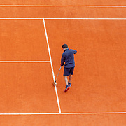 PARIS, FRANCE October 11.  A ground staff member cleans the lines for the Singles Final on Court Philippe-Chatrier during the French Open Tennis Tournament at Roland Garros on October 11th 2020 in Paris, France. (Photo by Tim Clayton/Corbis via Getty Images)