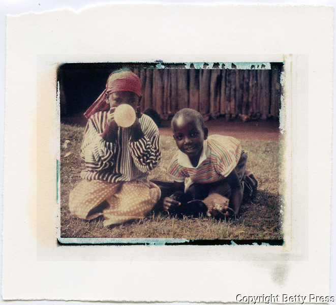 Blowing balloons and playing with a kitten.  <br /> Image size 4x5, Matted 12x10  Edition of 25 Archival Pigment Print