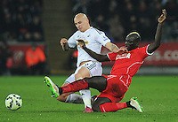 Liverpool's Mamadou Sakho vies for possession with Swansea City's Jonjo Shelvey<br /> <br /> Photographer Kevin Barnes/CameraSport<br /> <br /> Football - Barclays Premiership - Swansea City v Liverpool - Monday 16th March - The Liberty Stadium - Swansea<br /> <br /> © CameraSport - 43 Linden Ave. Countesthorpe. Leicester. England. LE8 5PG - Tel: +44 (0) 116 277 4147 - admin@camerasport.com - www.camerasport.com