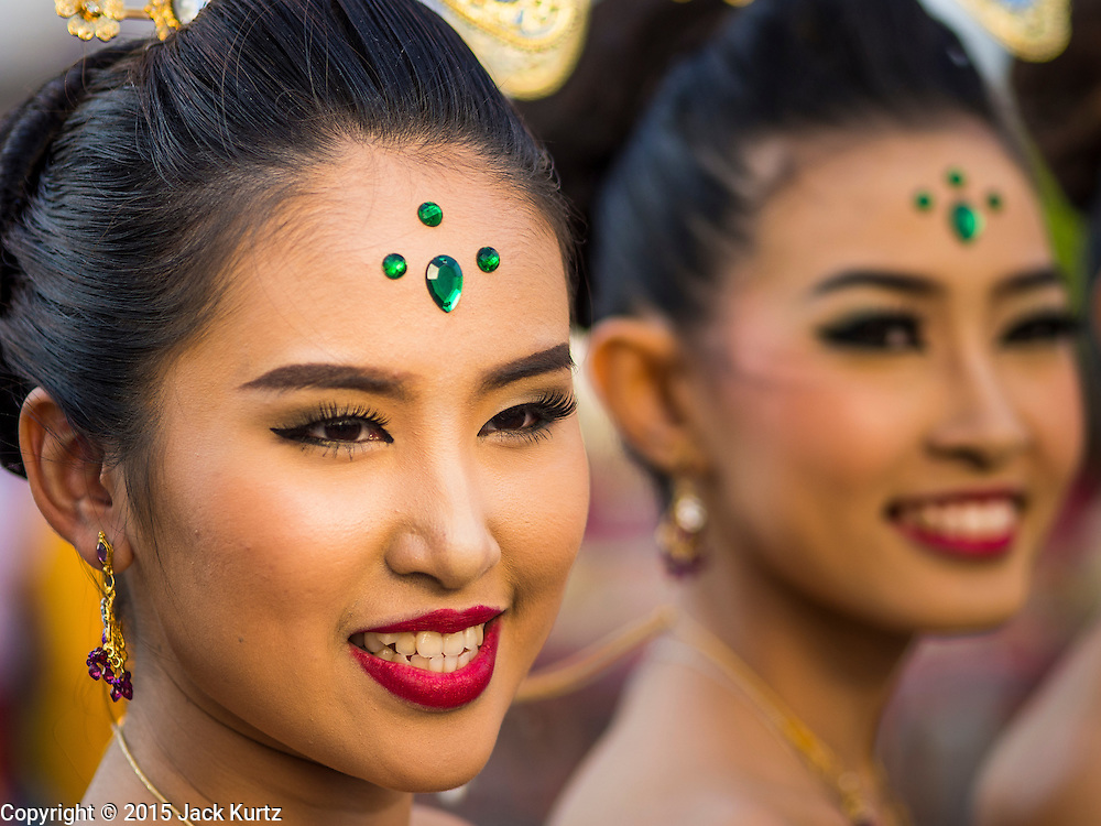 """14 JANUARY 2015 - BANGKOK, THAILAND:  Women in traditional attire march in the 2015 Discover Thainess parade. The Tourism Authority of Thailand (TAT) sponsored the opening ceremony of the """"2015 Discover Thainess"""" Campaign with a 3.5-kilometre parade through central Bangkok. The parade featured cultural shows from several parts of Thailand. Part of the """"2015 Discover Thainess"""" campaign is a showcase of Thailand's culture and natural heritage and is divided into five categories that match the major regions of Thailand – Central Region, North, Northeast, East and South.    PHOTO BY JACK KURTZ"""