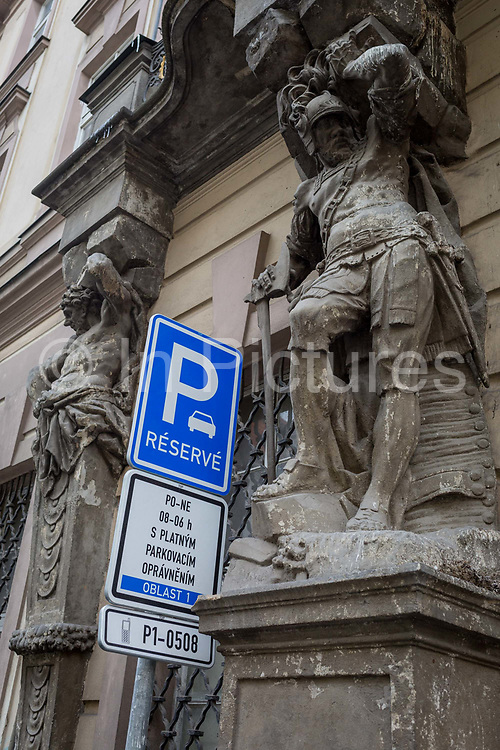 A parking restriction sign and an ornate heritage building in the centre of the Czech capital, on 18th March, 2018, in Prague, the Czech Republic.