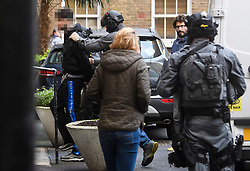 **Unpixelated version available**<br /> © Licensed to London News Pictures. 19/11/2018. London, UK. A man being detained by police during a raid by a CT-SFO (Counter Terrorist Specialist Firearms Officer) unit at a residential block of flats in Westminster, London. A number of men were detained at the scene. Photo credit: Ben Cawthra/LNP