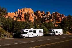 Recreational Vehicles, RVs, Red Canyon in, Dixie National Forest between Bryce Canyon National Park and Zion National Park, Utah, UT, rock formation, landform, arid, Southwest America, American Southwest, US, United States, Image ut422-18212, Photo copyright: Lee Foster, www.fostertravel.com, lee@fostertravel.com, 510-549-2202