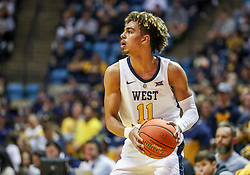 Nov 24, 2018; Morgantown, WV, USA; West Virginia Mountaineers forward Emmitt Matthews Jr. (11) looks to pass during the second half against the Valparaiso Crusaders at WVU Coliseum. Mandatory Credit: Ben Queen-USA TODAY Sports