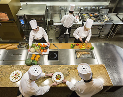 March 29, 2013 - A view looking down on a crew of chefs working in a commercial kitchen, (Credit Image: © Mint Images via ZUMA Wire)