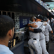 NEW YORK, NEW YORK - May 31:  Tyler Saladino #18 of the Chicago White Sox and team mate Brett Lawrie #15 of the Chicago White Sox hug in the dugout before the Chicago White Sox Vs New York Mets regular season MLB game at Citi Field on May 31, 2016 in New York City. (Photo by Tim Clayton/Corbis via Getty Images)