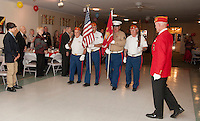 Commandant Robert Patenaude presents colors during the 239th birthday celebration of the Marine Corp Saturday evening at Pheasant Ridge.  (Karen Bobotas/for the Laconia Daily Sun)