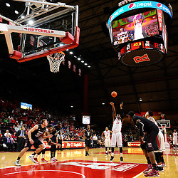 Junior Etou #10 of the Rutgers Scarlet Knights takes a free throw during the second half of Rutgers men's basketball vs Temple Owls in American Athletic Conference play on Jan. 1, 2014 at Rutgers Louis Brown Athletic Center in Piscataway, New Jersey.