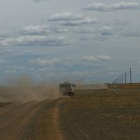 Tourist vans bump on a dusty road near Dalanzadgad in the Gobi Desert, Mongolia.