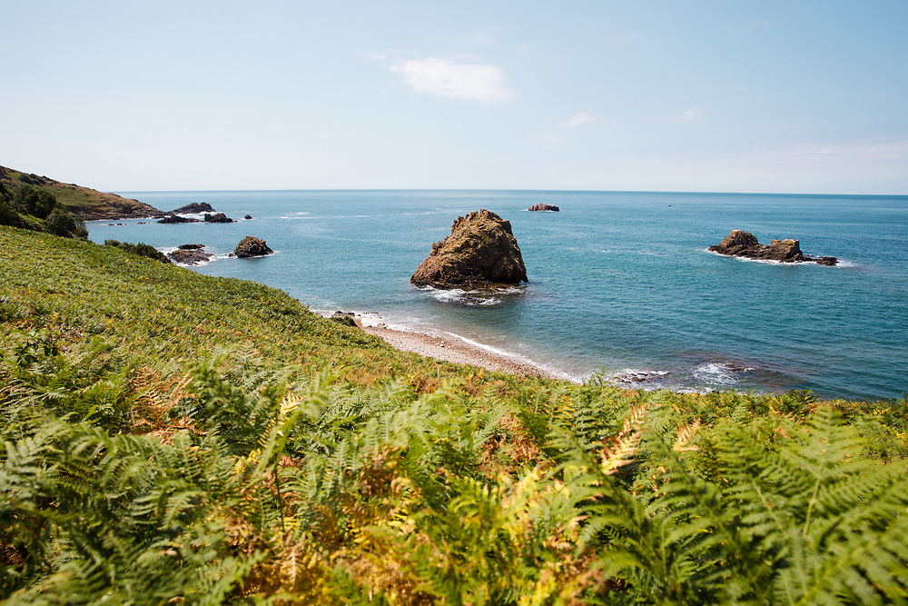 Views of the south coast hidden beaches on a calm sunny day in Jersey, Channel Islands