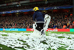 7 March 2017 - UEFA Champions League - (Round of 16) - Arsenal v Bayern Munich - A fire officer clears the pitch of paper thrown by the Bayern fans - Photo: Marc Atkins / Offside.