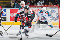 KELOWNA, CANADA - JANUARY 18: Devante Stephens #21 of the Kelowna Rockets back checks Jayden Halbgewachs #12 of the Moose Jaw Warriors as he skates with the puck during first period on January 18, 2017 at Prospera Place in Kelowna, British Columbia, Canada.  (Photo by Marissa Baecker/Shoot the Breeze)  *** Local Caption ***