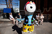 One of many differently decorated or painted versions of London 2012 Olympics mascot Wenlock. This character has bcome extremely popular especially amongst the young who love to have their picture taken with him. London, UK.