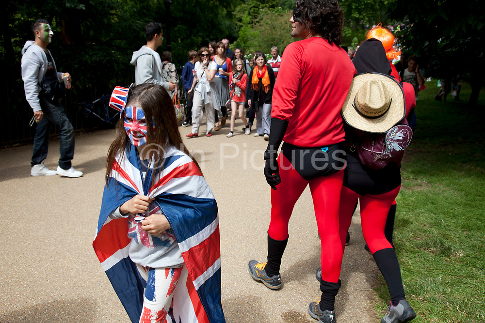 London, UK. Tuesday 7th August 2012. Men's Triathlon held in Hyde Park. Fans of the event gather to watch in various outfits and guises.