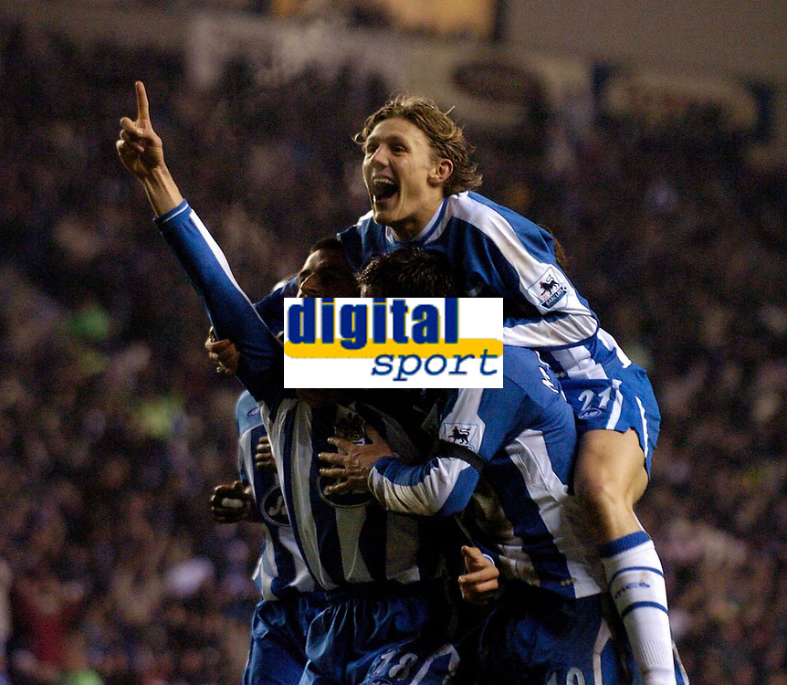 Photo: Jed Wee.<br /> Wigan Athletic v Manchester United. The Barclays Premiership. 06/03/2006.<br /> <br /> Wigan's Jimmy Bullard (top) joins the celebrations with goalscorer Paul Scharner (L).