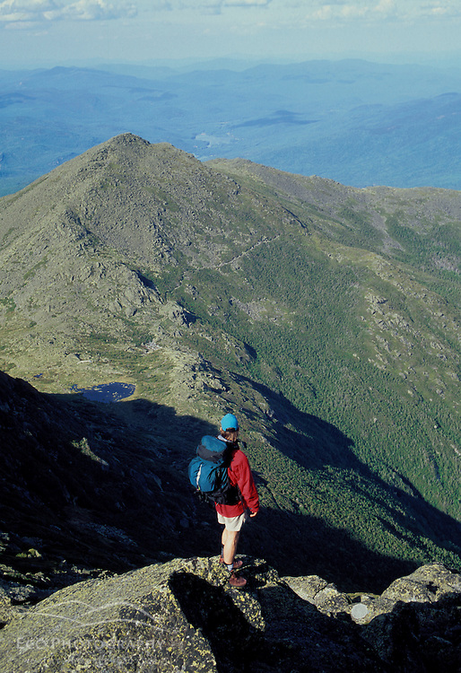 A hiker looks to Mt. Madison from Mt. Adams the second highest peak in NH.  Mt. Adams, NH
