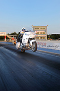Tommy Bolton on 2008 Honda Goldwing GL1800 doing a wheelie at Thunder Valley Raceway drag strip in Noble, Oklahoma