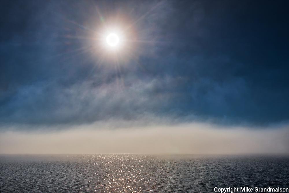 Sunburst and fog on Long Lake<br />Longlac<br />Ontario<br />Canada