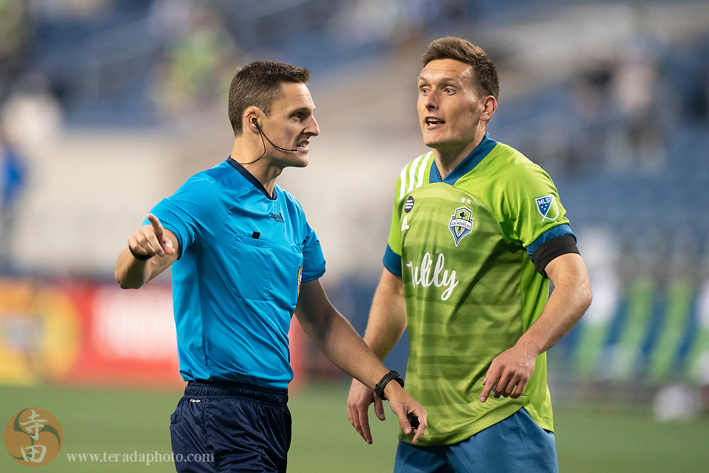 April 16, 2021; Seattle, Washington, USA; MLS referee Joe Dickerson (left) and Seattle Sounders FC defender Shane O'Neill (27) during the second half against the Minnesota United FC at Lumen Field.