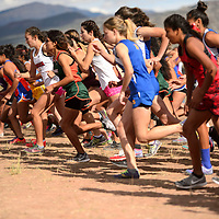 The varsity leave the start line under Mount Taylor at the Grants High School Invitational cross country meet in Grants Friday.