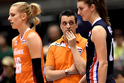 15-05-2016 JAP: OKT Nederland - Zuid Korea, Tokio<br /> Er is nog niets verloren, maar de volleybalsters van Oranje hebben tijdens het OKT een gevoelige 3-0 nederlaag geleden tegen Zuid-Korea / Teleurstelling bij Coach Giovanni Guidetti, Debby Stam-Pilon #16, Anne Buijs #11