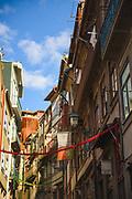 Balconies and various decorations on small street (Rua das Flores), Porto, Portugal Ⓒ Davis Ulands   davisulands.com