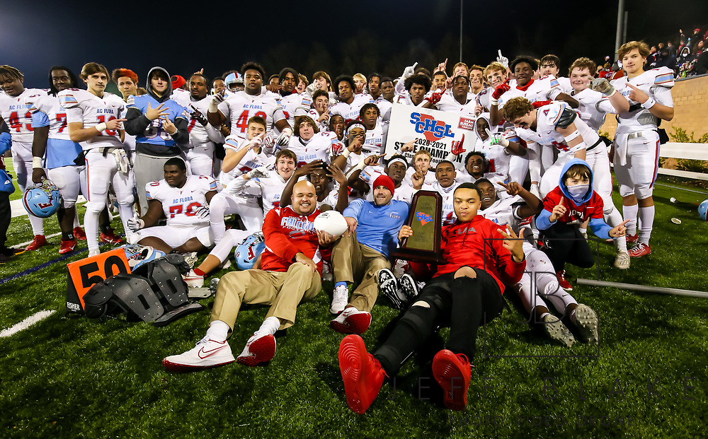 AC Flora Falcons players pose following their State Championship win over the North Myrtle Beach Chiefs at Benedict College.