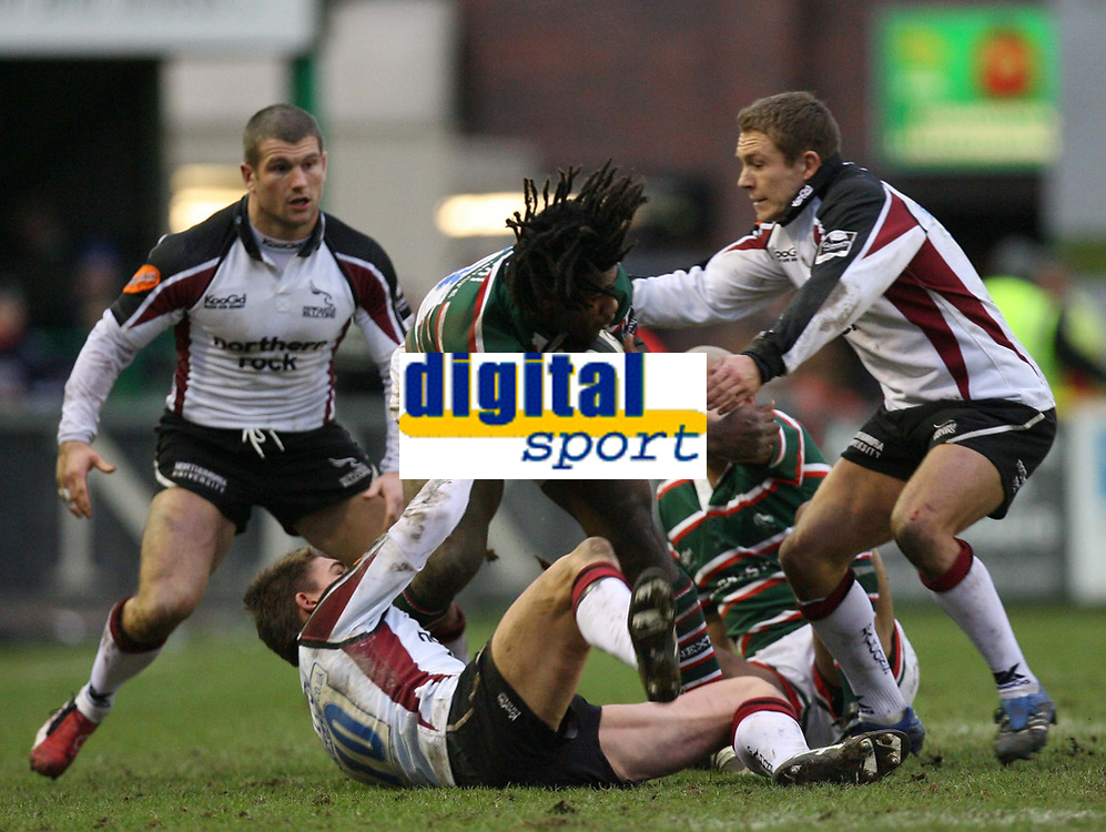 Photo: Rich Eaton.<br /> <br /> Leicester Tigers v Newcastle Falcons. Guinness Premiership. 27/01/2007. Jonny Wilkinson of Newcastle Falcons right assists Toby Flood #10 in tackling Seru Rabeni of Tigers