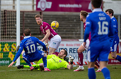 06MAR21 Queen of the South's James Maxwell on way to scoring their second goal. Arbroath 2 v 4 Queen of the South, Scottish Championship played 6/3/2021 at Arbroath's home ground, Gayfield Park.
