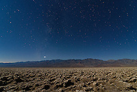 Devil's Golf Course in Death Valley is filled with these sharp and jagged salt formations. In the distance the planet Venus can be seen setting over the Panamint Range.