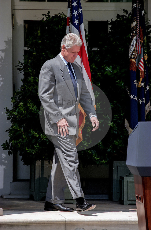US President Bill Clinton walks out to the podium to condemn the recent bombings in Nairobi, Kenya and Dar es Salaam, Tanzania, in the Rose Garden of the White House August 7, 1998 in Washington, DC.