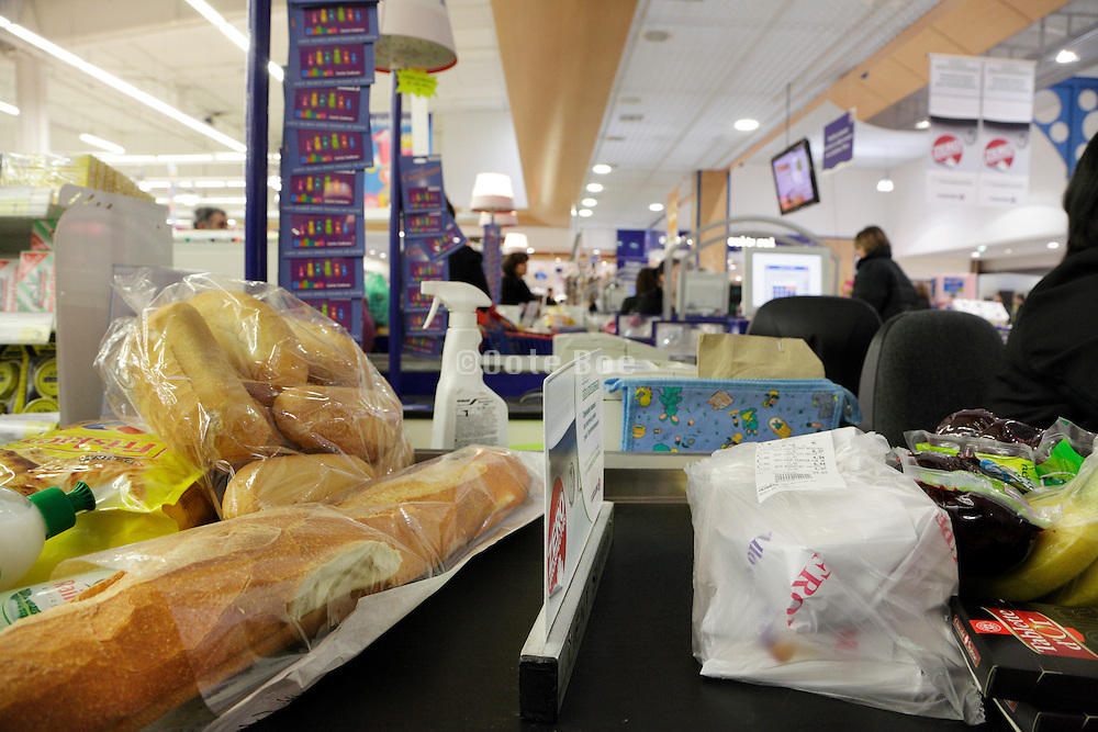 groceries by the cashier in a supermarket