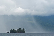 """Rain shower on the rainforest, near Kap Araide, Kumawa Peninsula, mainland New Guinea, Western Papua, Indonesian controlled New Guinea, on the Science et Images """"Expedition Papua, in the footsteps of Wallace"""", by Iris Foundation"""